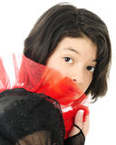 Hiding Behind Red Frills Stock Image