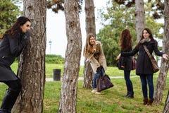 Hiding behind a tree Royalty Free Stock Photos