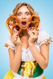 Hiding behind two pretzels. Royalty Free Stock Images