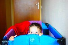 Hiding boy Stock Photos