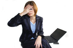 Hiding business woman. Hiding behind her hand Young business woman with laptop hiding Royalty Free Stock Photo