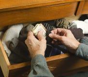Hiding cash in sock Stock Image
