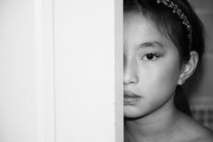 Hiding Child-Book Cover. Child hiding behind a door Royalty Free Stock Images