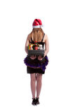 Hiding christmas presents. Blond caucasian girl standing backside and holding christmas gifts hided behind isolated over white Stock Photos