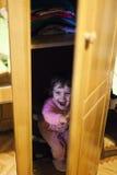 Hiding in closet Royalty Free Stock Photos