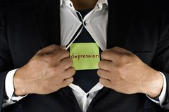 Hiding depression. A man in suit opening and unbuttoning his inner shirt to reveal his depression. The word depression is written royalty free stock image