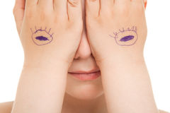 Hiding eyes close up Stock Images