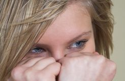 Hiding the face. Attractive young blonde hiding her face behind her hands Stock Photo