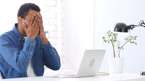 Hiding Face in Frustration, Upset Afro-American Man at Work Royalty Free Stock Image