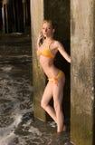 Hiding Girl. Attractive girl under a pier Stock Photography