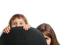Hiding girls Stock Image