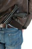 Hiding a gun Stock Photo