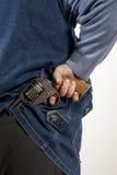 Hiding gun Royalty Free Stock Images