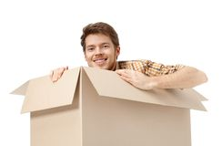 Hiding inside the box Royalty Free Stock Image