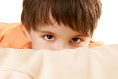 Hiding kid. Close-up portrait of hiding child isolated on white background Stock Photos