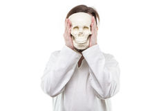 Hiding man with human skull Royalty Free Stock Photo