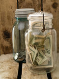 Hiding Money in Mason Jars Stock Photo