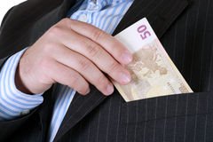 Hiding money in pocket. Stock Image