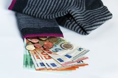 Hiding money in socks is an insecure investment. Hiding money in socks Royalty Free Stock Image