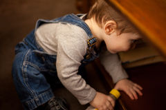 Hiding from mummy and daddy Stock Photography