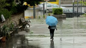 Hiding from rain people rushing about their business, meteorological forecast. Stock footage stock video footage