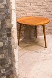 Hiding round wood side table Royalty Free Stock Image