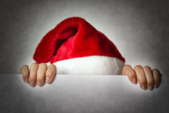 Hiding Santa woman Royalty Free Stock Photos