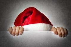 Hiding Santa woman. Image of Santa woman hiding behind a wall Royalty Free Stock Photos