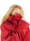 Hiding spy girl. Blond girl hiding in red jacket Royalty Free Stock Image