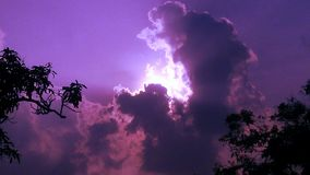 Hiding Sun. Scene of sun hiding in Clouds. Giving purple shade Royalty Free Stock Photo
