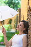 Hiding from sun with umbrella Stock Image