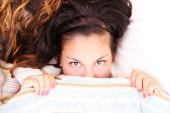 Hiding under a blanket. A young woman hiding under a blanket Royalty Free Stock Photo