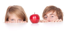 Hiding young couple Royalty Free Stock Photos