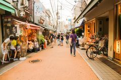 Hiding. Young foreigners hiding from their parents in this shopping street at tokyo japan Stock Images