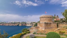 Hidirlik tower in Kas town in Antalya timelapse hyperlapse with view of harbor marine bay is a old city. Blue cloudy sky at summer day stock footage