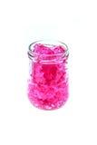 hidrogel rosado en la botella de cristal aislada en blanco Imagen de archivo libre de regalías