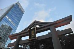 Hie Jinja Shrine inscription and Skyscraper. Entrance to the Hie Jinja Shrine inscription in Japanese. The Hie Shrine is a Shinto shrine in Nagatacho, Chiyoda Stock Images