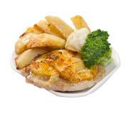 Hiebe mit Kartoffeln auf plate.closeup Lizenzfreie Stockfotografie