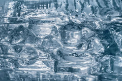 Hielo o vidrio transparente de la textura Fondo de plata Foto de archivo