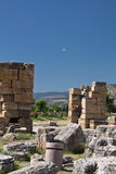 Hierapolis, pamukkale, Turkey - July 8, 2012: beautiful ancient ruins of castle in hierapolis, with parachute in the back in blue Royalty Free Stock Photography