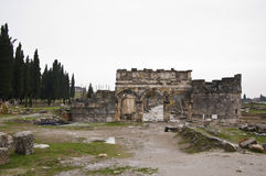Hierapolis. The ruins of entrance gate of ancient Hierapolis at cloudy day Stock Photos
