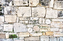 Ruins of Hierapolis city - Landmark attraction in Pamukkale, Turkey. Wall background. Ancient ruins of Hierapolis city - Landmark attraction in Pamukkale, Turkey Royalty Free Stock Photography