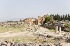 Hierapolis, Turkey. View of Frontinus street (I century AD) and the ruins of the Byzantine Northern gate (IV century AD) royalty free stock photo