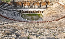 The amphitheatre of Hierapolis ancient city in Pamukkale, Denizli in Turkey. Hierapolis was an ancient city located on hot springs in classical Phrygia in Royalty Free Stock Photo