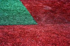 Hierba roja en el césped, textura natural de la hierba Imagenes de archivo