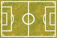 Hierba verde, campo de fútbol con las líneas blancas foto de archivo