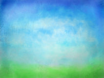 Hierba verde texturizada con el fondo de la acuarela del cielo azul Foto de archivo