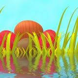 Hierba verde y ambiente de los medios de los huevos de Pascua Imagen de archivo libre de regalías