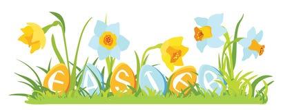 Hierba y flores con los huevos decorativos Foto de archivo libre de regalías