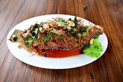 Hierbas de la fritada de pescado Imagenes de archivo